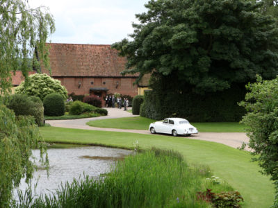 Wedding car approach to Suffolk barn wedding venue