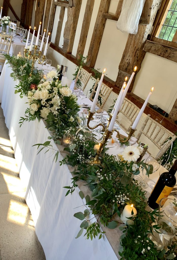 Top table decoration at barn wedding venue