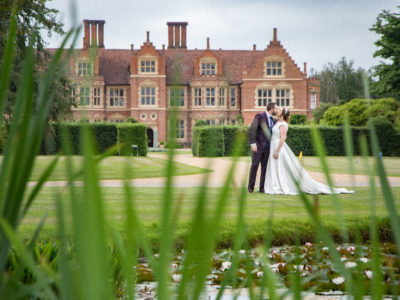 Wedding photography in front of Jacobean manor house Suffolk