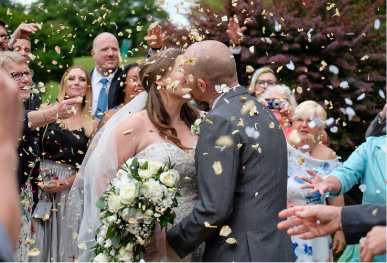 Family run wedding venue Suffolk - confetti - wedding photography