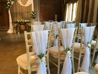 Ceremony Room - chair backs - barn wedding venue Suffolk